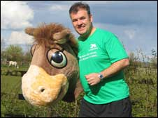 Mark Owen HorseWorld's MD, dressed as Horace the HorseWorld mascot
