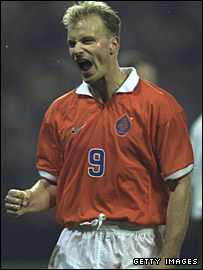 Dennis Bergkamp celebrates his hat-trick against Wales in 1996