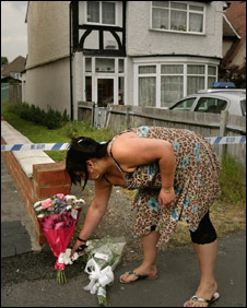 Neighbour leaving flowers outside the family's home