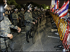 Riot police face protesters at Bangkok protest 31 May