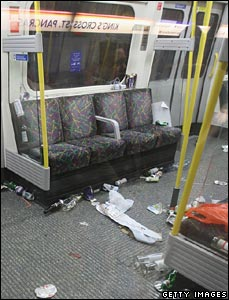 Empty carriage strewn with litter