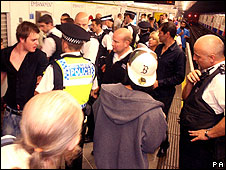 Police and revellers on a Circle line platform