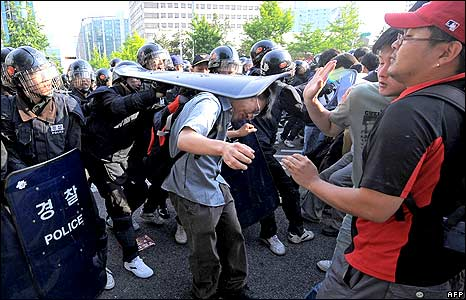 Protester being hit by riot police shield 1/6/08