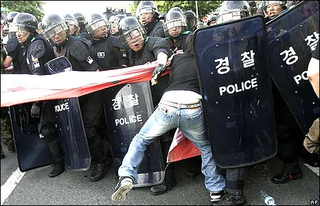 Man being detained by Seoul riot police 1/6/08