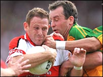 Derry's Paul Murphy runs into Donegal defender Eamon McGee
