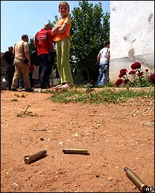 Spent cartridges lie near a house in Aracinovo on 1 June