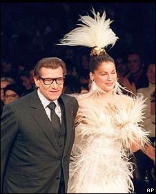 Saint-Laurent with French model Laetitia Casta on the catwalk for his Haute Couture spring/summer 2000 collection
