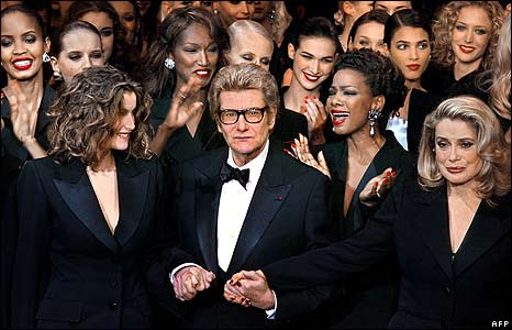 Yves Saint Laurent at his last Haute-Couture show, in 2002; Catherine Deneuve stands to his left