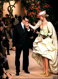 French designer Yves Saint Laurent kisses model Claudia Schiffer, on January 22 1997 in Paris, after the presentation of his Spring-summer Haute Couture collection