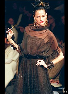A model presents a light black evening dress with a muslin veil during French designer Yves Saint-Laurent Haute Couture spring/summer 2000 collection presented in Parison 19 January 2000.