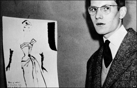 Yves Saint Laurent in 1954 with the prize-winning cocktail dress design that attracted Dior's attention