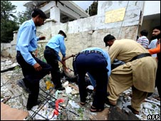 Police remove body at scene of blast