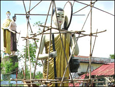Repairs to a cyclone-damaged Buddha statue in Rangoon on 1 June 2008