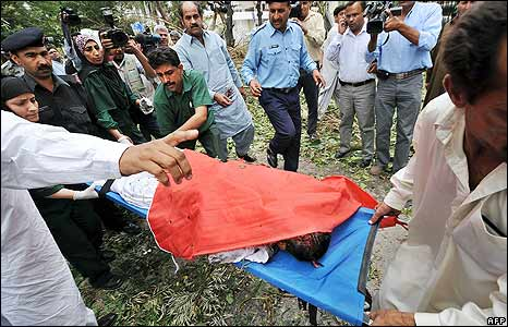 Victim of the blast is carried away on a stretcher