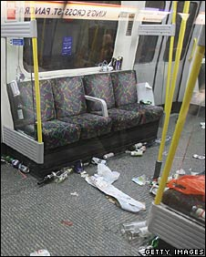 A Circle Line carriage littered with rubbish