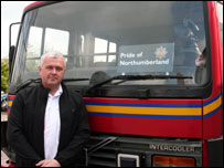 John Arnold with the fire engine