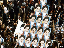 Demonstrators holding posters of Ayatollah