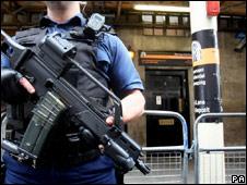 Armed police officer stands guard outside Park Lane Safe Deposit, Mayfair