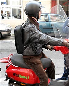 A Welldone agent on one of the firm's specially-branded scooters
