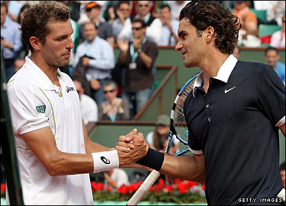 Julien Benneteau and Roger Federer