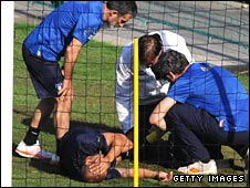 Fabio Cannavaro is attended by Italy's medical staff