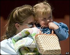 A woman from the Fundamentalist Church of Jesus Christ of Latter Day Saints reunites with her child. Photo: 2 June 2008