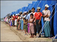 People line up at a government-run camp for the visit of UN chief Ban Ki-moon on 22 May 2008