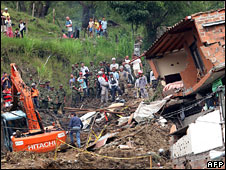 Rescue workers at the scene of a mudslide in Medellin, Colombia, 1 June