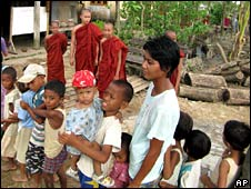 People queue to receive food at a monastery south of Rangoon on 1 June 2008