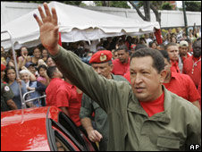 President Hugo Chavez waves to supporters in Caracas
