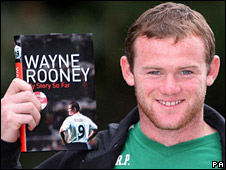 Wayne Rooney with his book