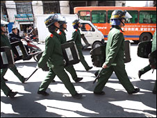 Chinese paramilitary police patrol Lhasa, Tibet, on 27 March 2008