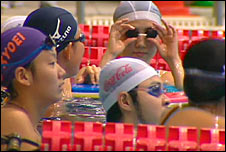 Japanese swimmers waiting at end of pool