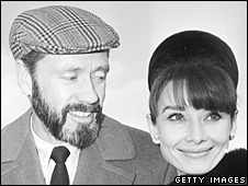 Mel Ferrer with his wife Audrey Hepburn at London airport, 19 January 1965
