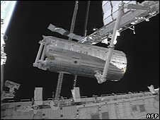 The Japanese Kibo lab is moved from the space shuttle Discovery's cargo bay for installation on the International Space Station, 3 June 2008