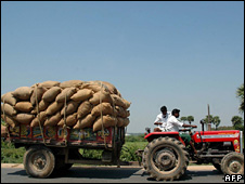 A farmer in India with his diesel fuelled tractor carrying food