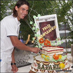 With victory in the bag, Nadal enjoys a slice of birthday cake as he celebrates turning 22