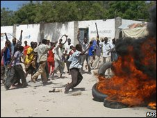 Somalis burn tyres and throw stones at a demonstration in Mogadishu against record-high inflation  (file picture)
