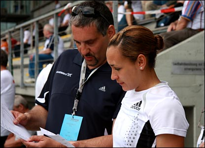 Coach Toni Minichiello and Jess Ennis review results