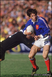 Philippe Sella is tackled by new Zealand's Warwick Taylor during the 1987 Rugby World Cup final