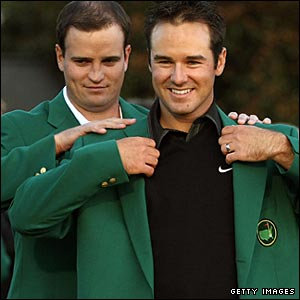 Trevor Immelman (right) is presented with the Masters Green Jacket by 2007 winner Zach Johnson