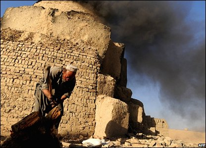 A man lighting a kiln