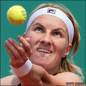 Fourth seed Svetlana Kuznetsova is in action on Suzanne Lenglen court against Estonia's Kaia Kanepi