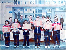 Class photo of children in front of school before quake