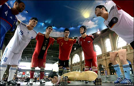 Giant sculptures of international football players on display at the main station in Zurich, Switzerland