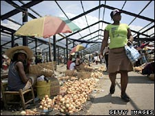 A woman shops at a market in Port-au-Prince, Haiti