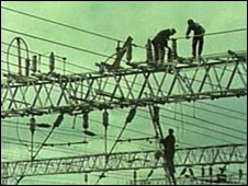 Workers on train power lines