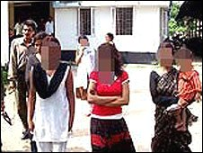 Assam trafficked women outside a police station