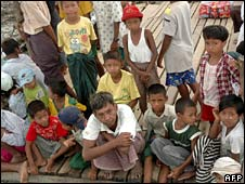 People wait to receive aid from private donors in the Irrawaddy Delta on 3 June 2008