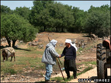 Druze shepherd and Druze farmer meeting in the Golan Heights